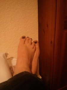 here is a picture of my feet that I sent to a man on the internet. Please do not judge me by the decor - it is not my flat