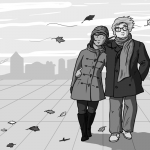 two people walking through autumn leaves