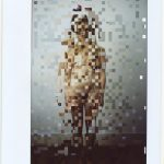 Pixellated image of a person posing naked