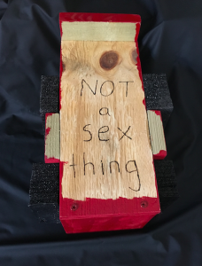 """Not a sex thing"" written on the bottom of the Fleshlight Launch mount"