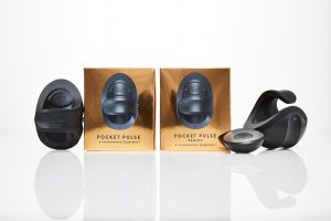 Picture of small, black Pocket PULSE sex toys next to gold boxes, one of the black toys has a circular remote sitting next to it