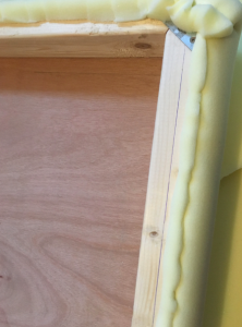 Memory foam looking a bit wonky with staple seams securing it to wooden frame