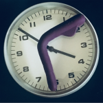 Picture of a simple wall clock with a Mysteryvibe Crescendo purple bendable vibrator lying on the clock face as if it is telling the time, to illustrate the idea of having a wank for an hour