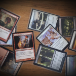 A picture of various Magic: the Gathering cards which were used during the game that this consent negotiation blog post was written about. Technically they should all add up to the start of the game I describe, because I care about accuracy and I am a nerd.