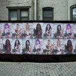 A wall in New York covered in posters of naked women showing the finger to the camera