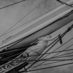 Pirate erotica - Black and white image of the prow of a ship with a bust of a woman on it