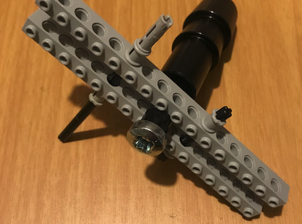 Image of a vac-u-lock attachment for a sex machine, with a lego support structure built around it