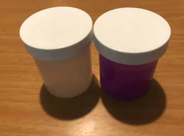 One small pot of clear fluid, one small pot of purple fluid