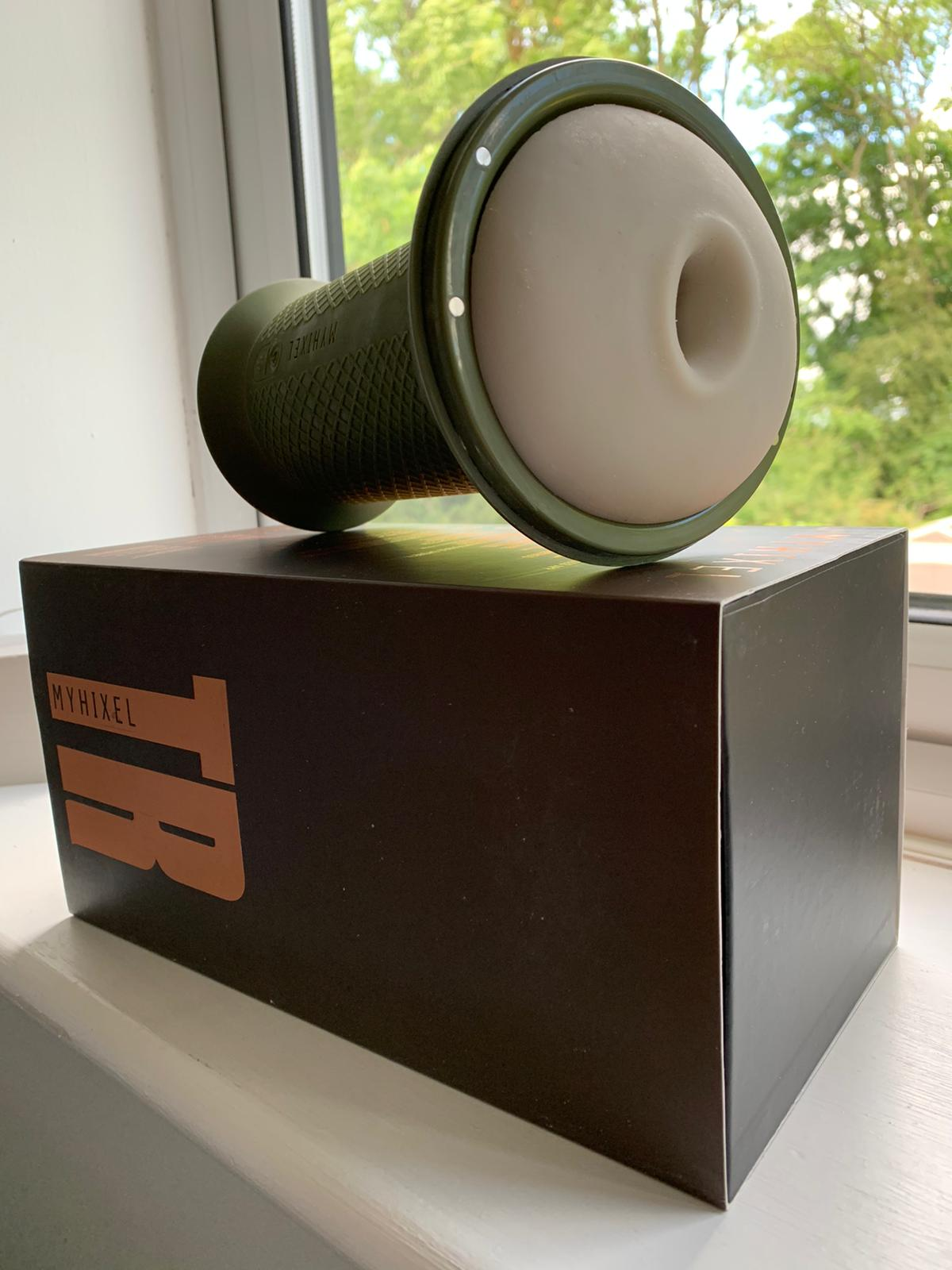 MyHixel device resting on its packaging, on the windowsill