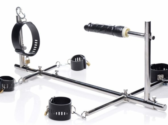 Metal stockade kinky kit with handcuffs plus dildo attached